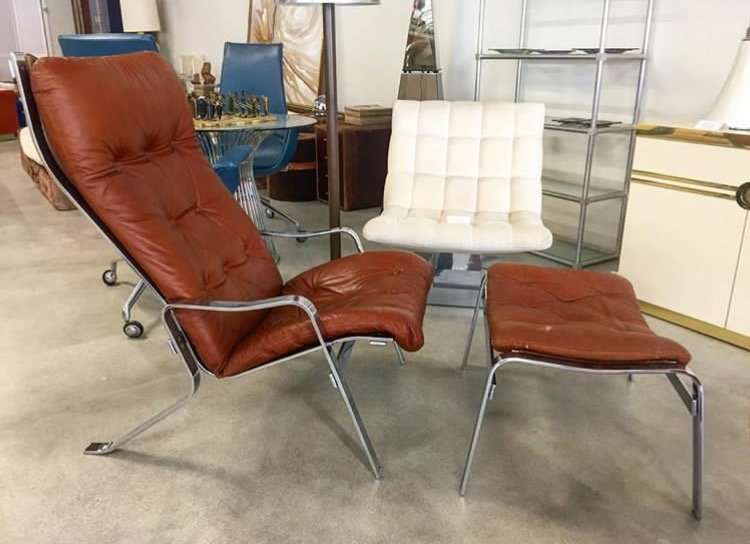 brown chair with foot rest