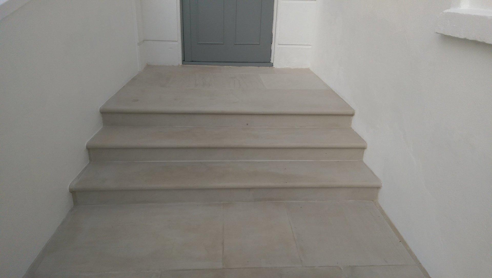 London Garden Builders design Beige Sawn Sandstone paving and steps. Front in Balham