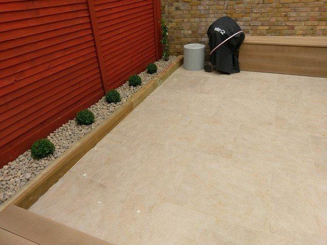 London Garden Builders design Golden Stone Porcelain Paving. Garden in Central London