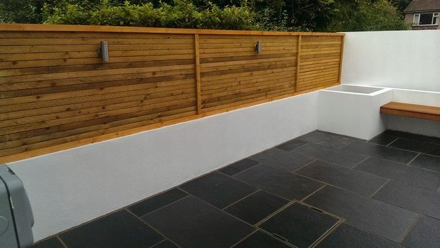 London Garden Builders design horizontal screen fence black limestone paving