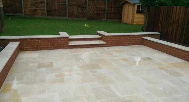 London Garden Builders design Multi Mint Sawn Sandstone Paving, new brick walls, Sawn Sandstone copings. Garden in Penge