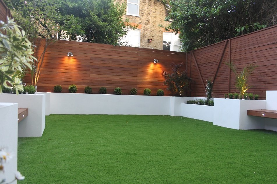 London Garden Builders artificial grass, retainind walls and beds, hardwood fence