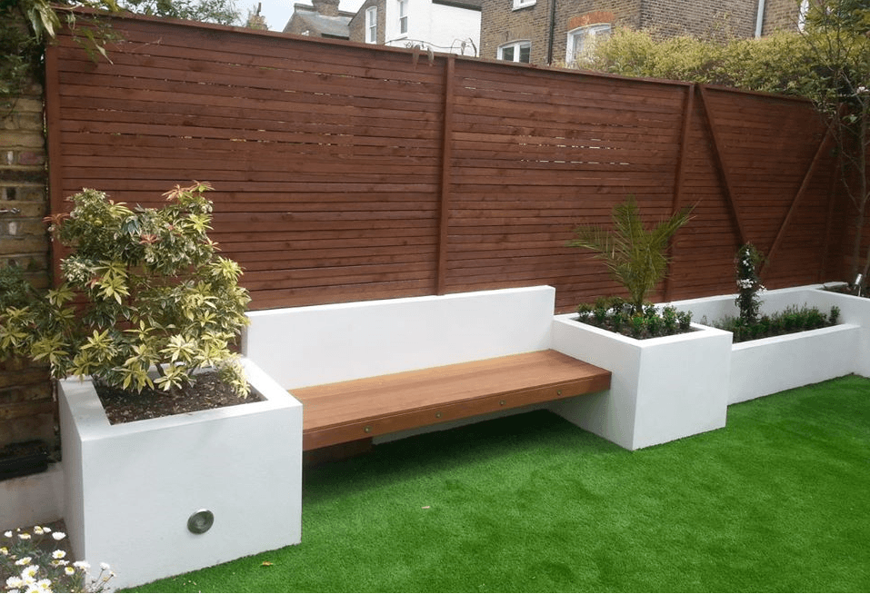 London Garden Builders design softwood trellis fencing hardwood bench retaining beds artificial lawn