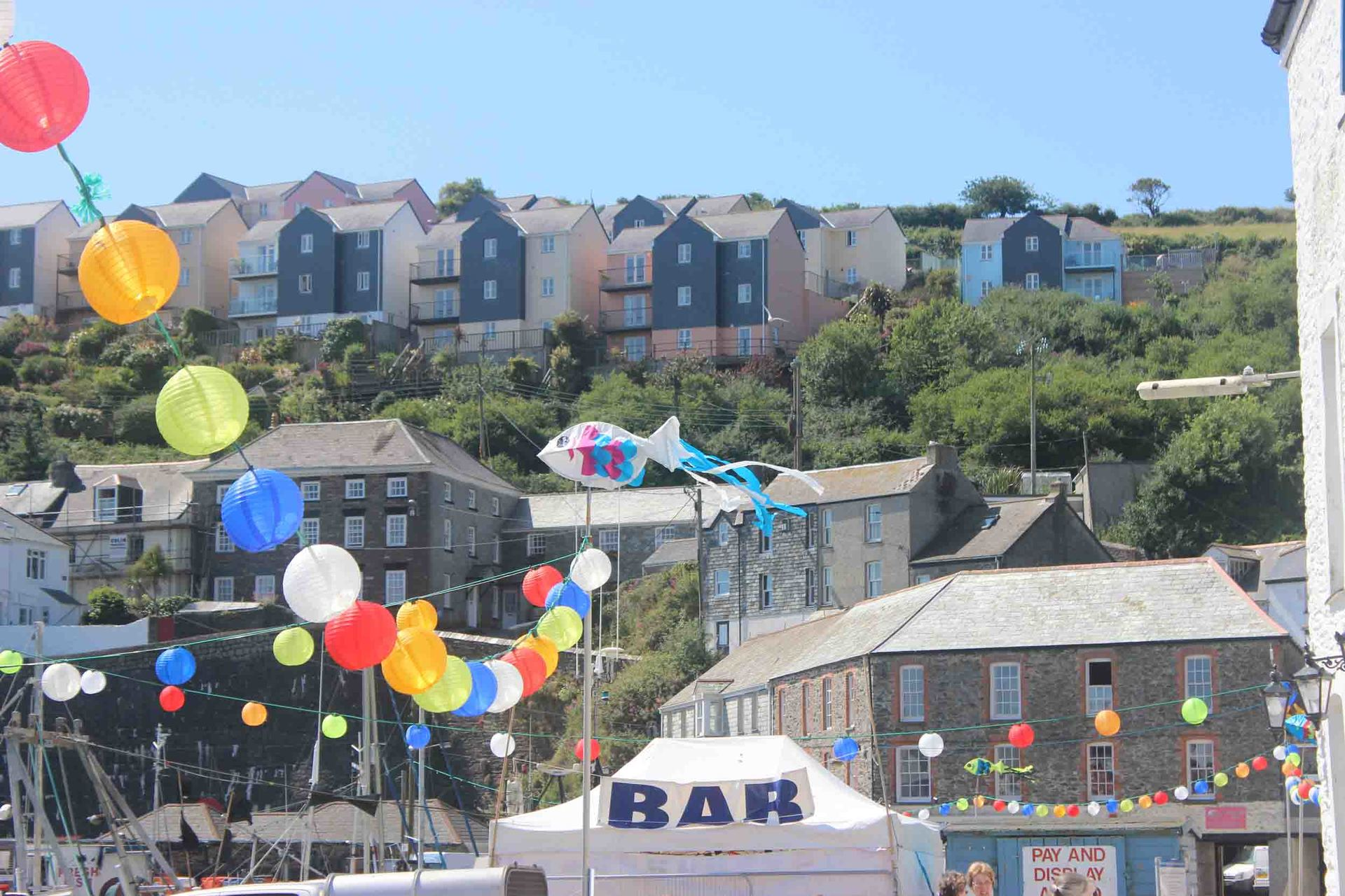 lanterns along the harbourside for Mevagissey Feast Week L A Kent Inspector Treloar Mysteries Silent Gull