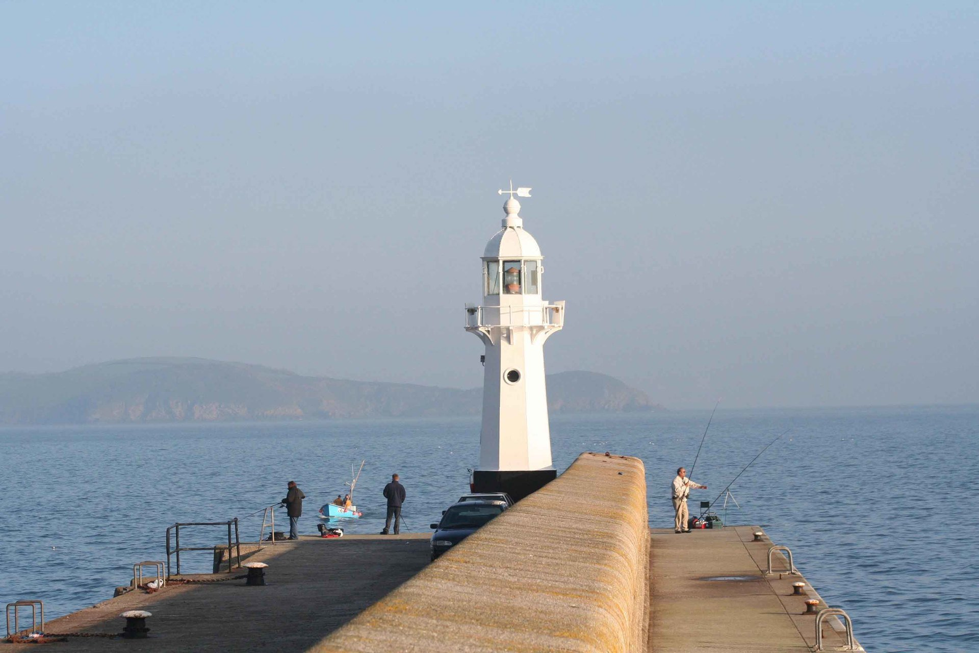 Mevagissey lighthouse Cornwall in photo gallery by L A Kent author of Rogue Flamingo