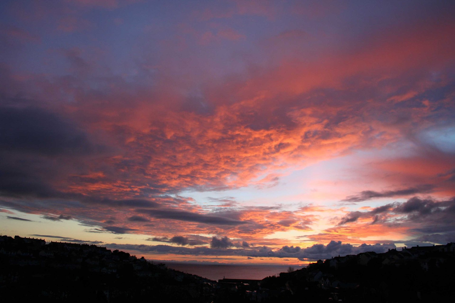 Sunrise over Mevagissey Cornwall in photo gallery by L A Kent author of Rogue Flamingo