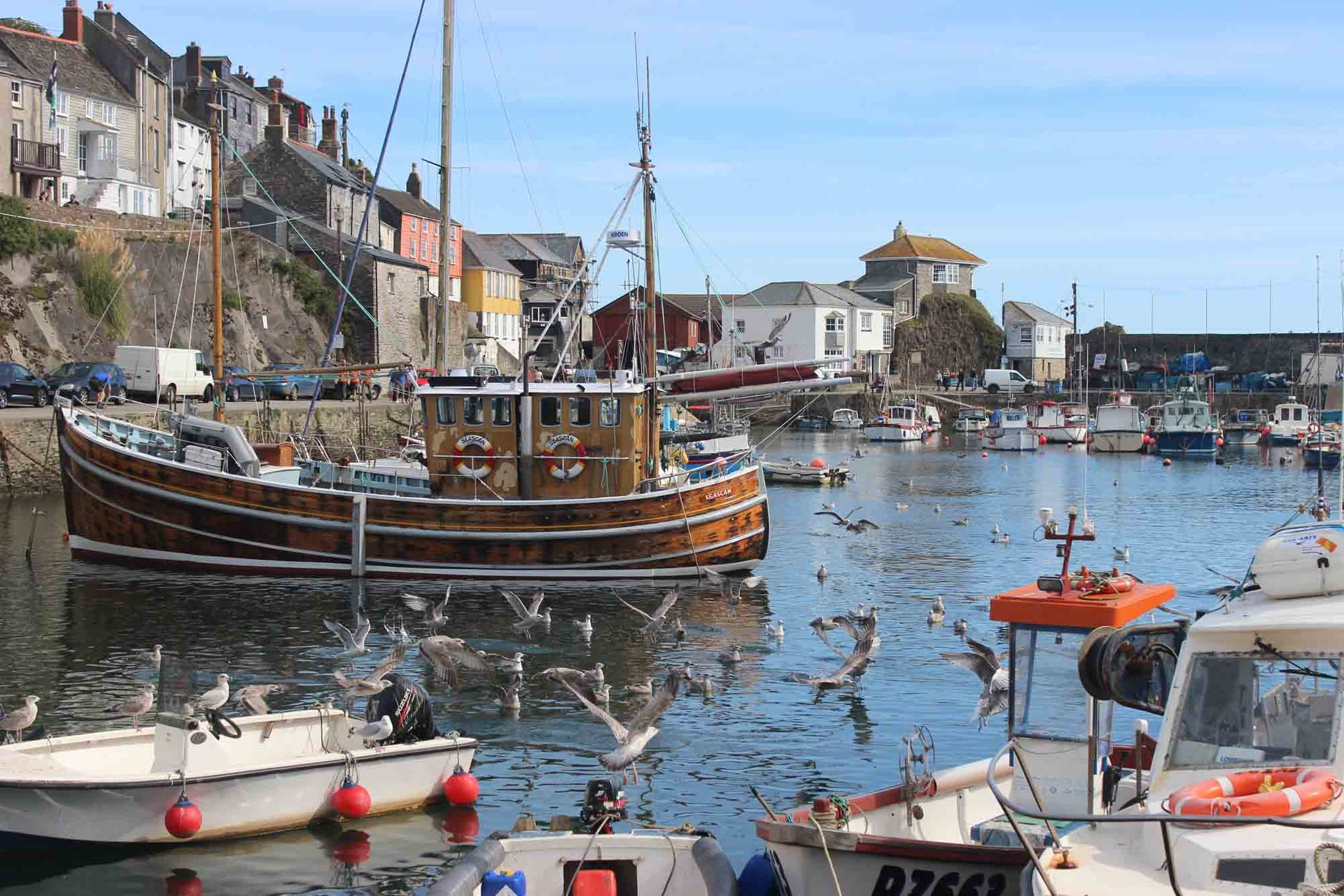 wooden fishing sail boat in Mevagissey harbour L A Kent Silent Gull Inspector Treloar Mysteries