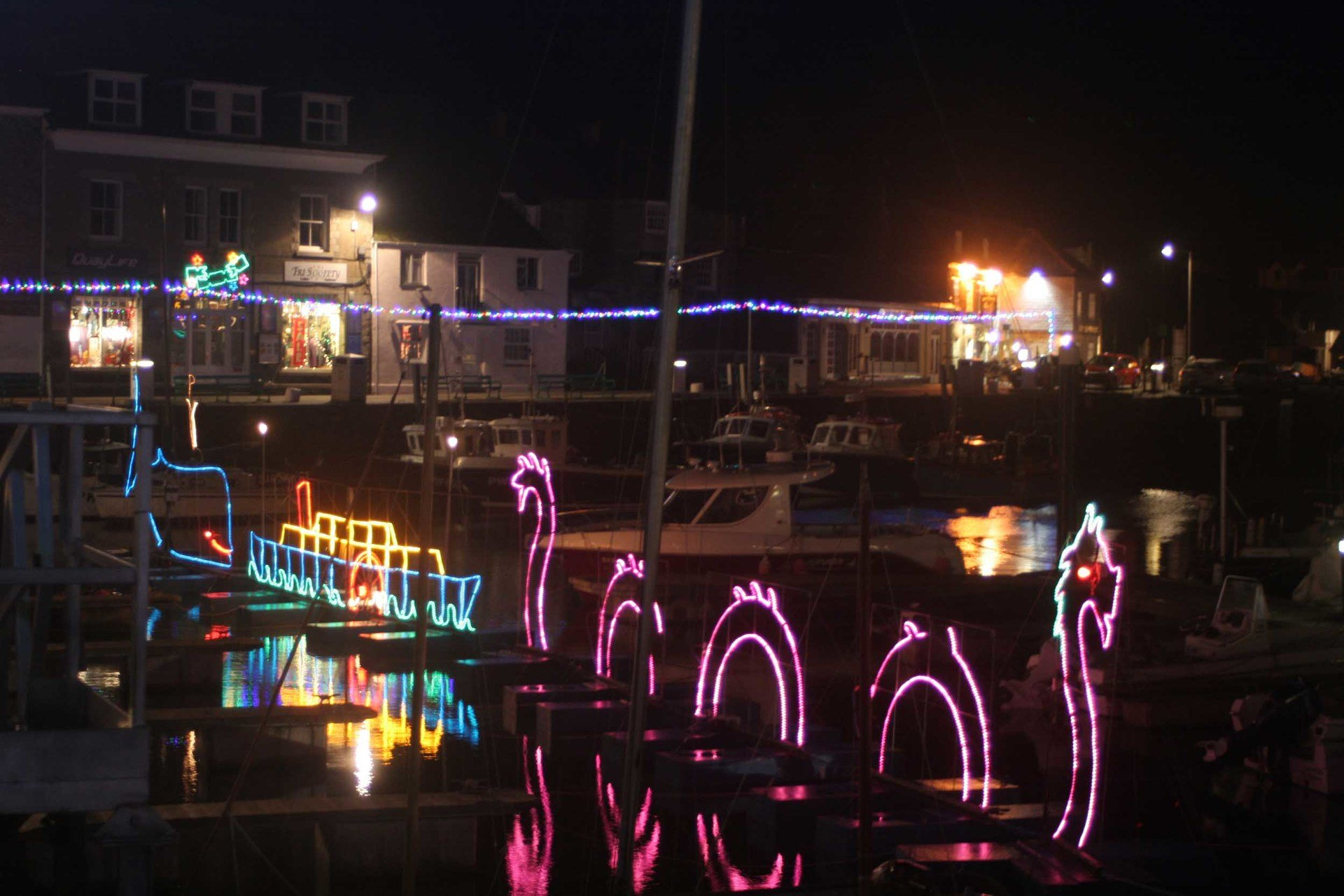 Padstow harbour  Christmas lights L A Kent DI Trelaor series Sad Pelican