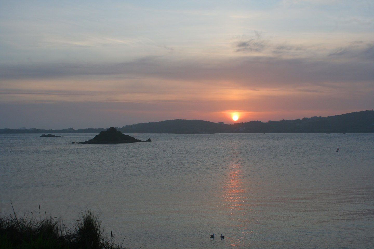 sunset over Bryher L A Kent D I Treloar series Sad Pelican