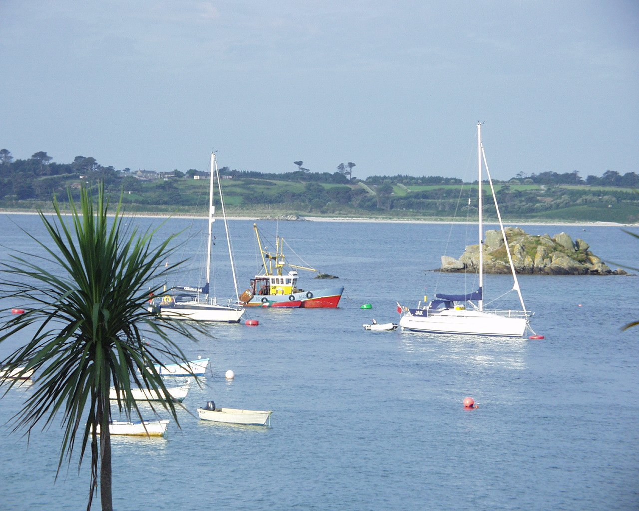 boats moored off St Martin's Isles of Scilly L A Kent Sad Pelican