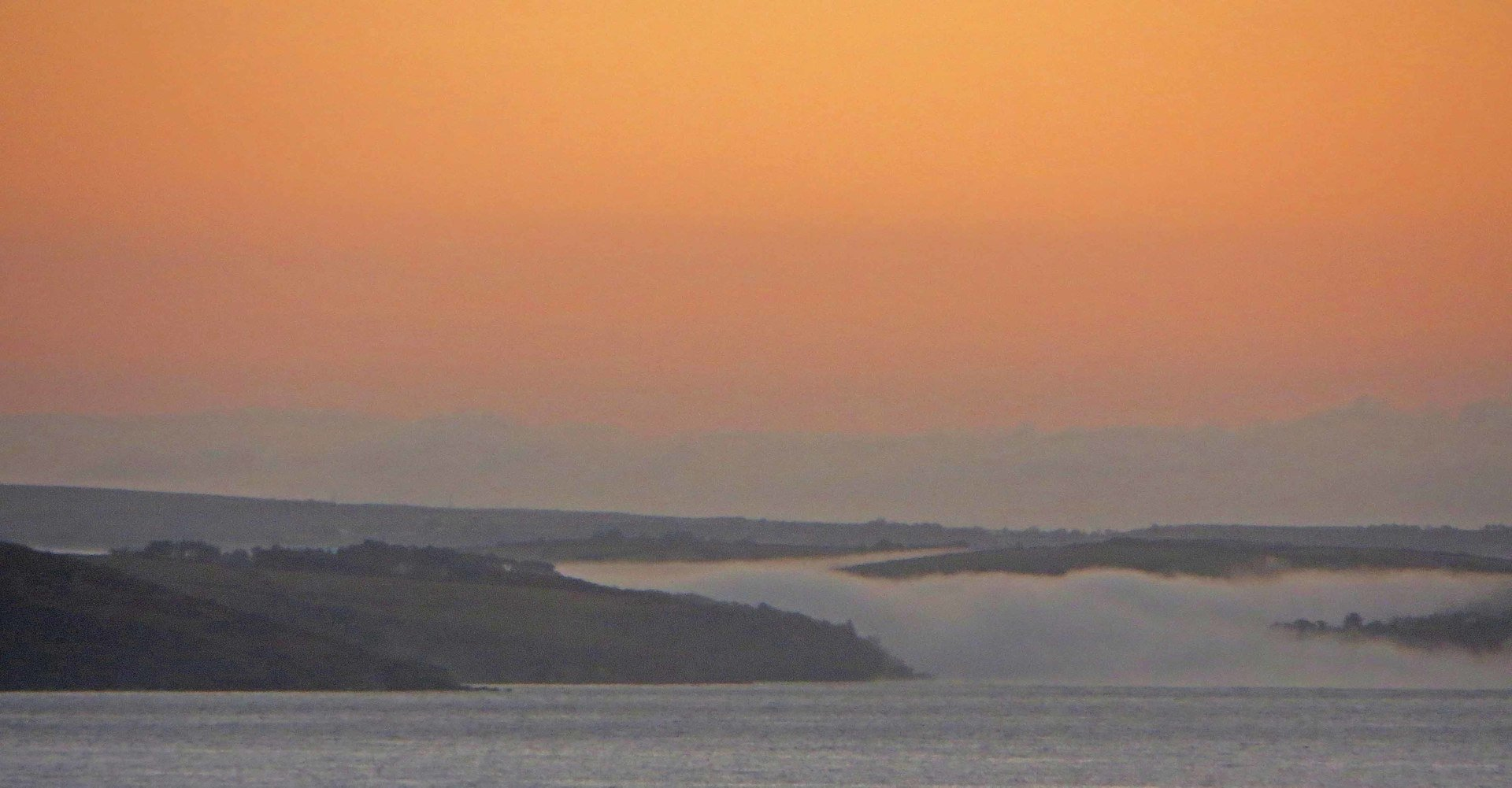 early morning mist rolls down to the sea from the River Fowey  Silent Gull by L A Kent Inspector Treloar Mysteries