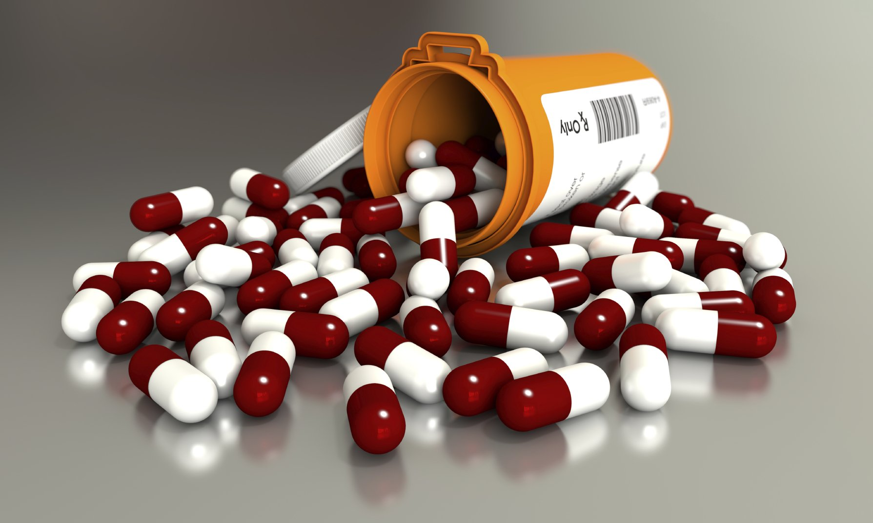 Prescription medication spilling out of container