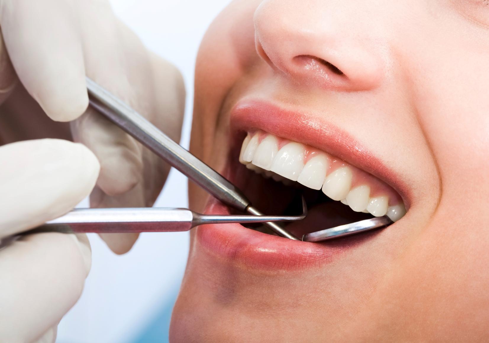 Person having teeth cleaned